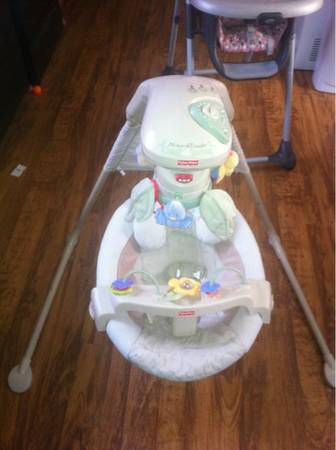 Natures touch cradle swing - $50 (North shreveport)