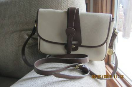 Dooney and Bourke All Weather Leather IvoryBrithish Tan Bag - $50 (North Bossier)