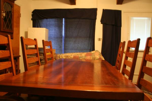 Beautiful Rustic Solid Pine Trestle Table W 6 Captains Chairs - $1500 (New Boston, Texas)