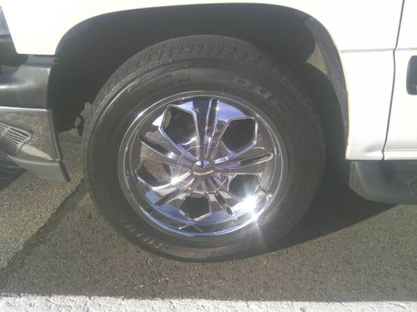20 INCH CHROME DEVINO RIMS 6 LUG WITH TIRES. LOOKING TO TRADE (HOT SPRINGS)