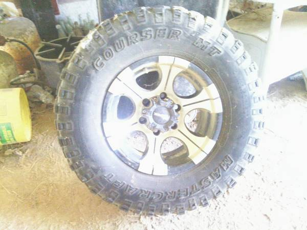 Dick Cepek rims on 31x10.5x15 mud tires - $350 (Texarkana)