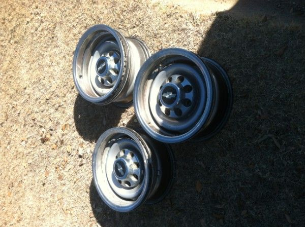 3 16 8 lug chevy rims, with four center caps beauty rings - $30 (pottsboro, tx)
