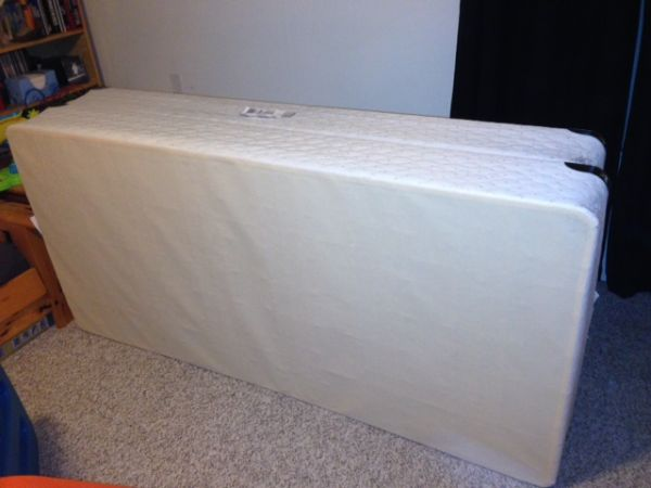 King size (or 2 twin xl) box spring - $20 (saanich)