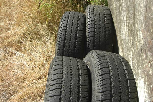 Four P24570r16 Goodyear Wrangler SRA Tires  - $150 (Saanich)