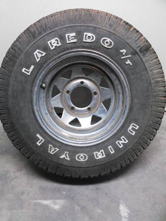 Jeep CJ wheel and tire 31x10.5x15 - $40 (hewitt)