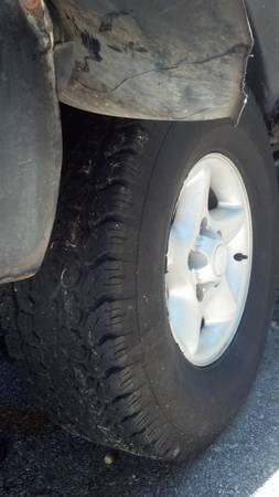 stock 97 dodge ram rims and tires - $550