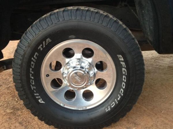 Ford 8 lug wheels and big tires - $750 (Luling)