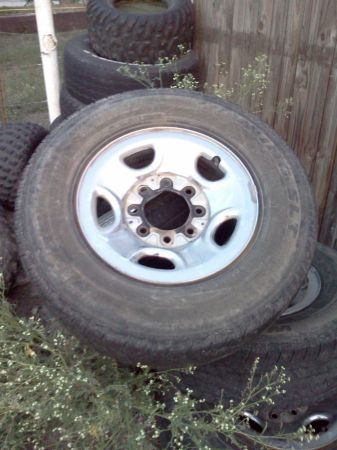8 lug chevy rims tires - $100 (Lorena)