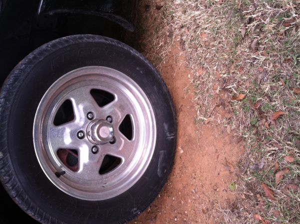 15 inch mustang alluminum rims and tires - $1 (Franklin tx)