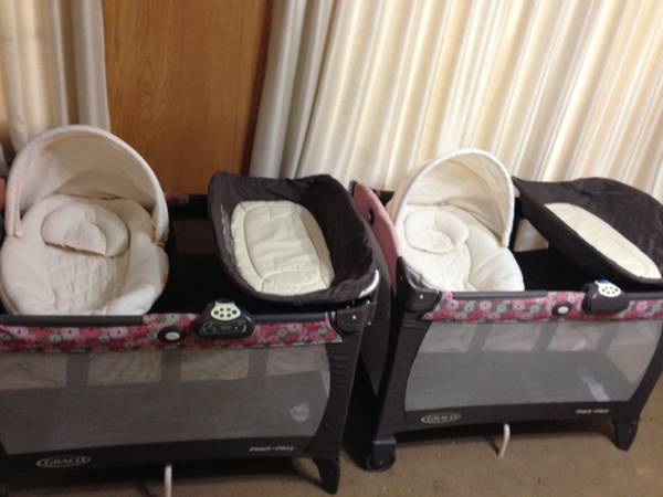 Two Graco Pack n Plays - Brown  Pink Blossoms - $100 (Waco)