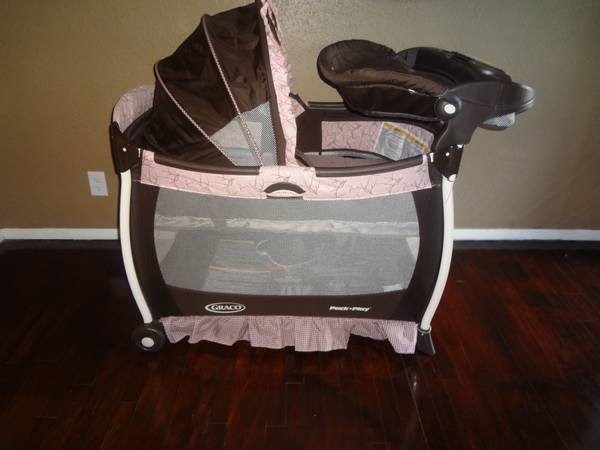 Graco Pack n Play pink and brown - $65 (Waco )