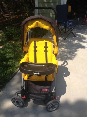Joovy caboose sit n stand stroller - $100 (Woodway)