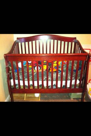 Dark cherry wood crib - $125 (waco, tx)