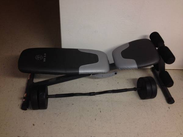 Golds gym bench wcurl bar and weights - $50 (waco)