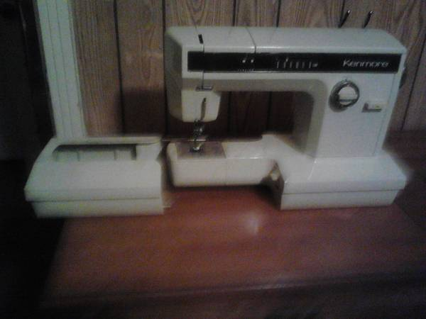 Kenmore sewing machine with cabinet - $150 (waco)